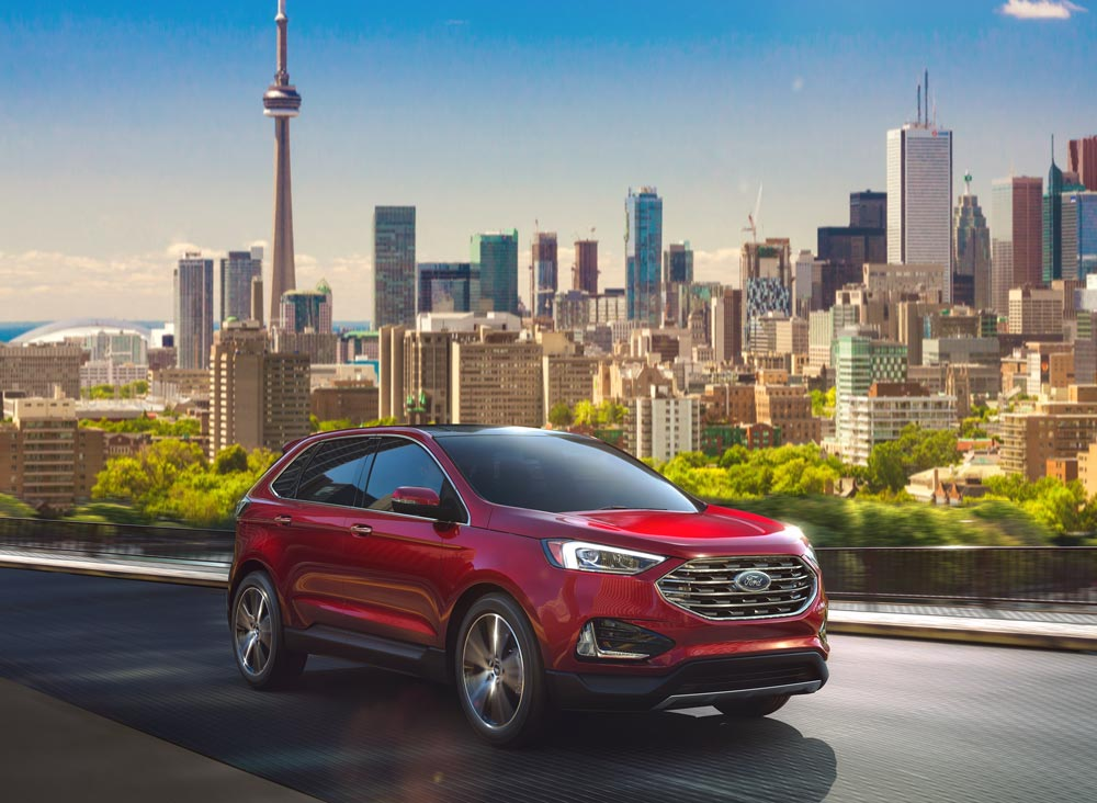 Ford SUV with Toronto in the background